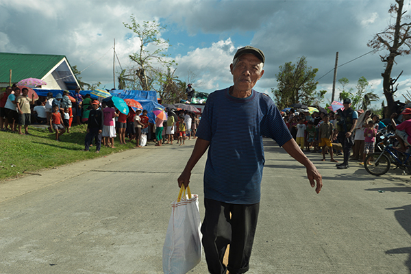 Man walking after typhoon in Philippines