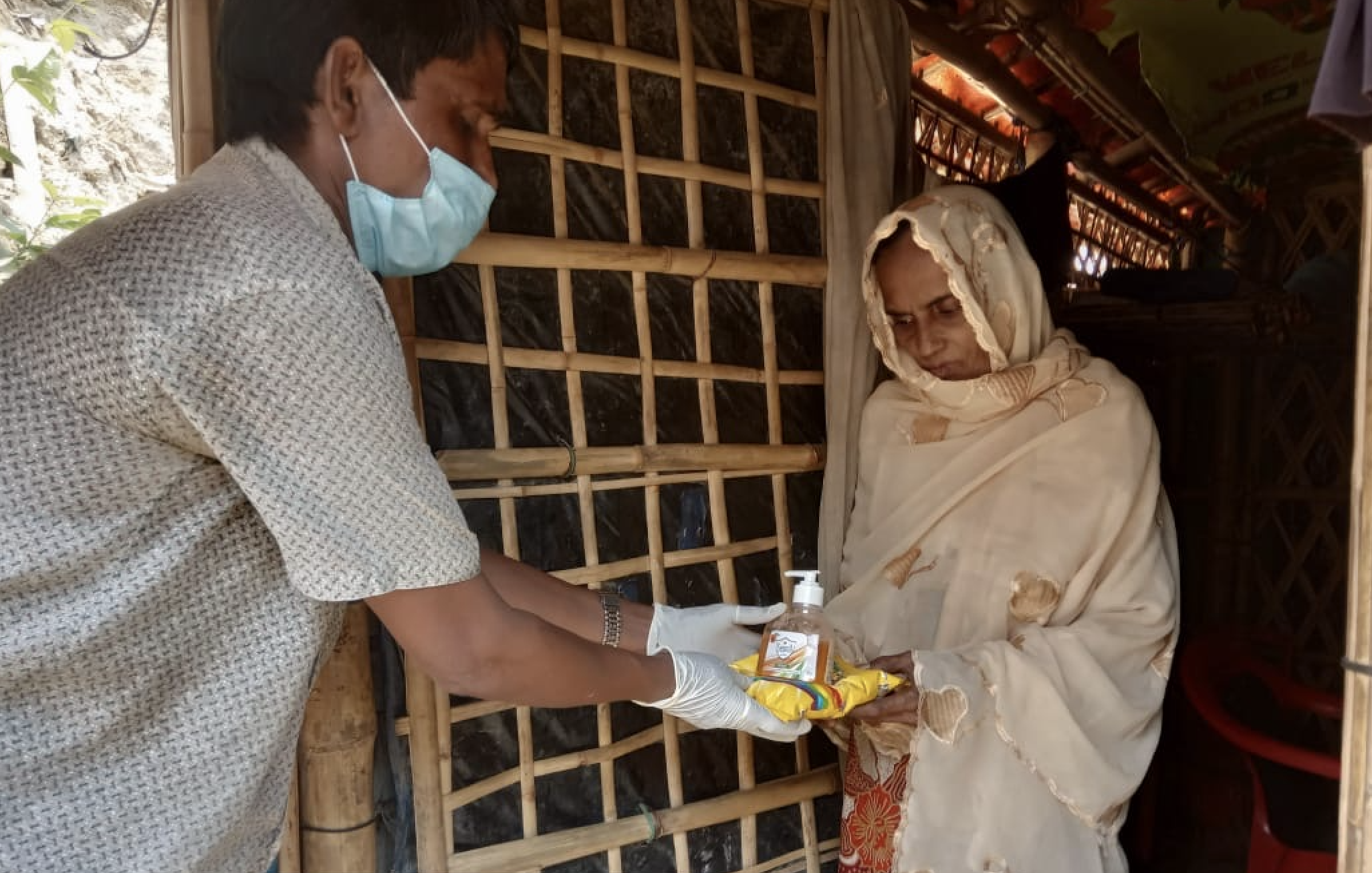 A health worker handing out antibacterial gel and other equipment to at risk older people in the communities during the coronavirus crisis