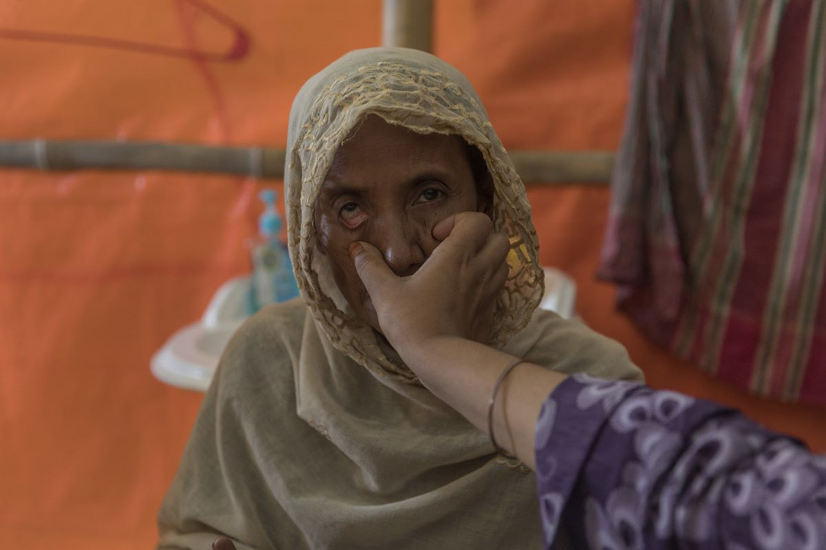 An older Rohingya refugee has her eye's examined in Age International's Age Friendly Space