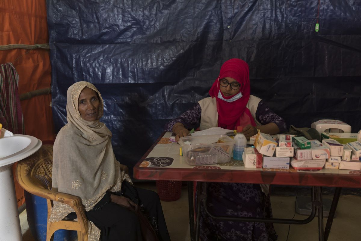 An older Rohingya refugee has a medical check  in Age International's Age Friendly Space in Bangladesh