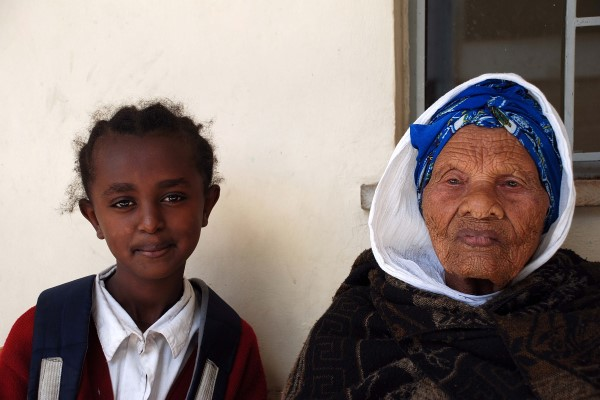 Turnesh stands with her young granddaughter in Ehtiopia