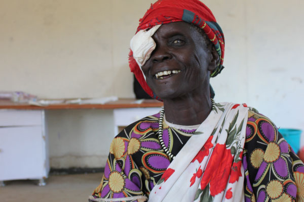 60-year-old grandmother Nyabel smiles after her cataract operation (copyright: Erna Mentesnot Hintz/ HelpAge International)