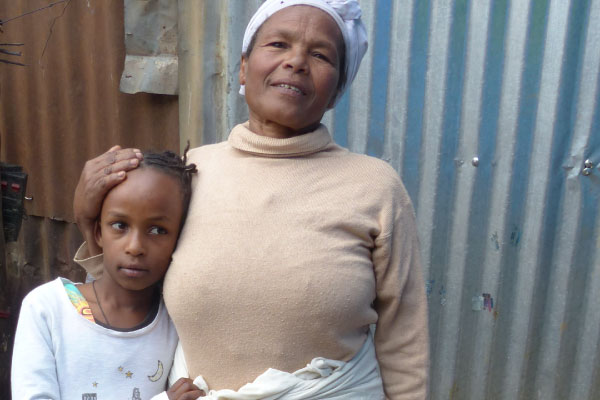 Aselefech and her granddaughter Mekedos, who is one of the people she cares for.