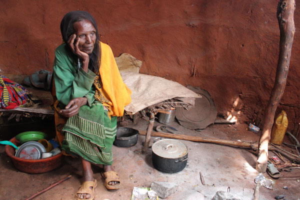 Older woman in Ethiopia with head in hand