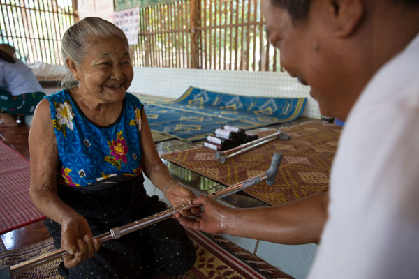 Daw Mya Ichin Phone, 81, from Myanmar collects her walking stick. Taken by Hereward Holland